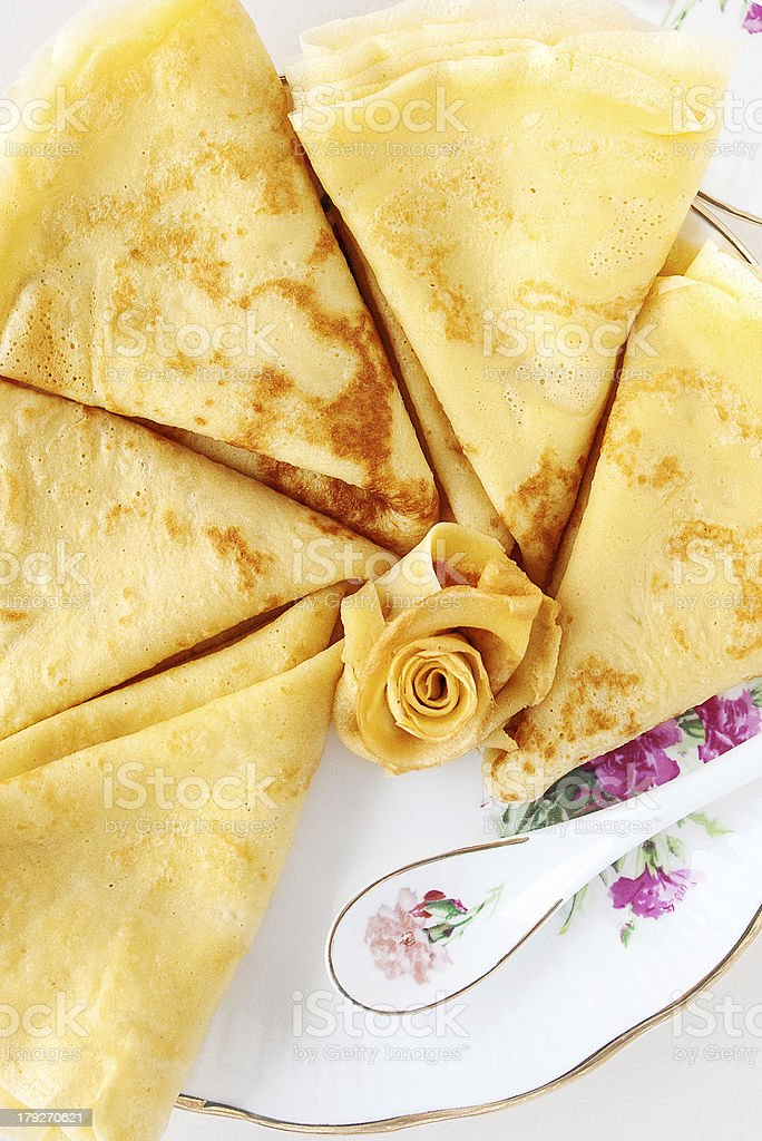 Slim pancakes on a porcelain plate royalty-free stock photo