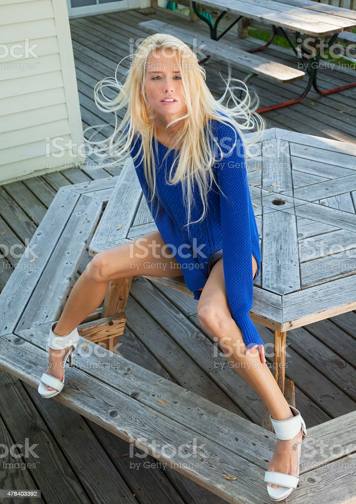 Slim Sexy Model in Blue Sweater , High Heels, Tossing Hair stock photo