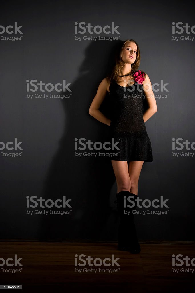 Slim sexy woman on dark background royalty-free stock photo