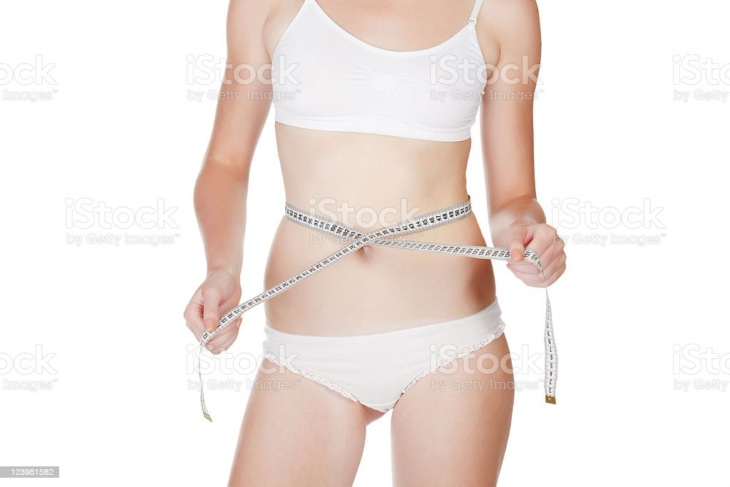 Slim waist with a tape measure royalty-free stock photo
