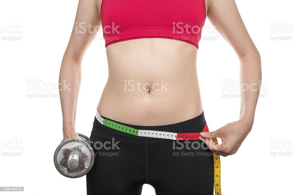 Slim waist with dumbbells stock photo