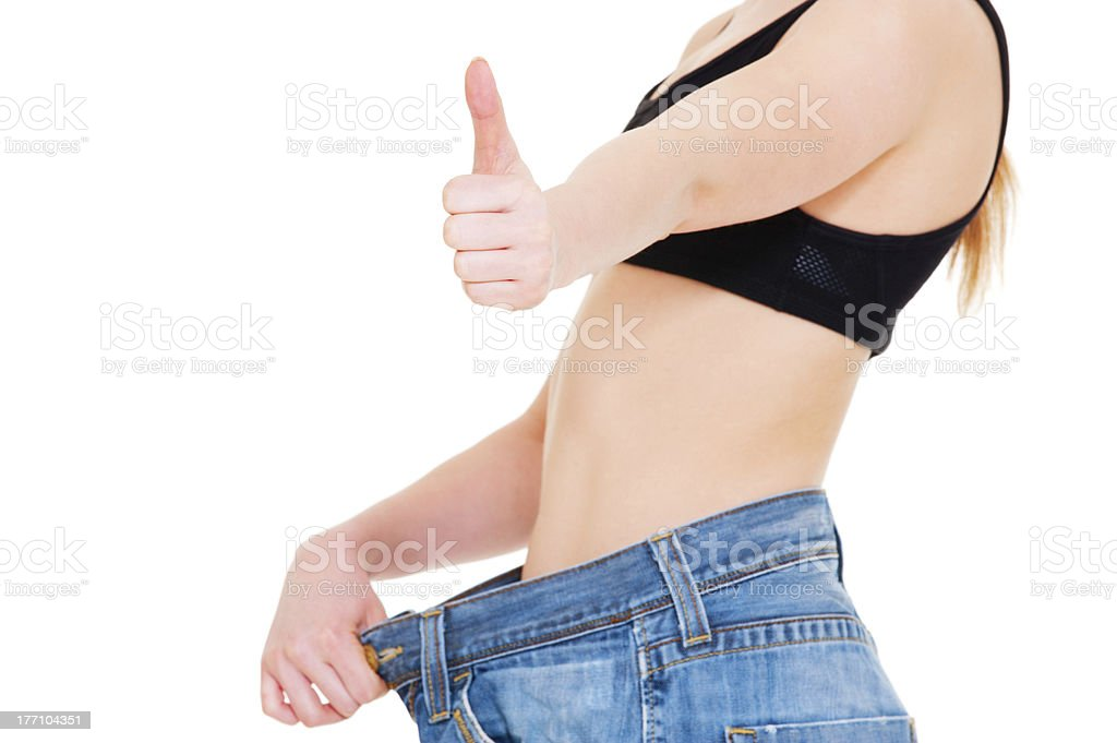 slim woman in big jeans royalty-free stock photo