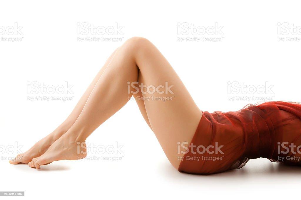 Slim woman lying on white background stock photo