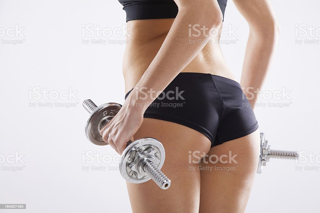 Slim woman with dumbbells stock photo