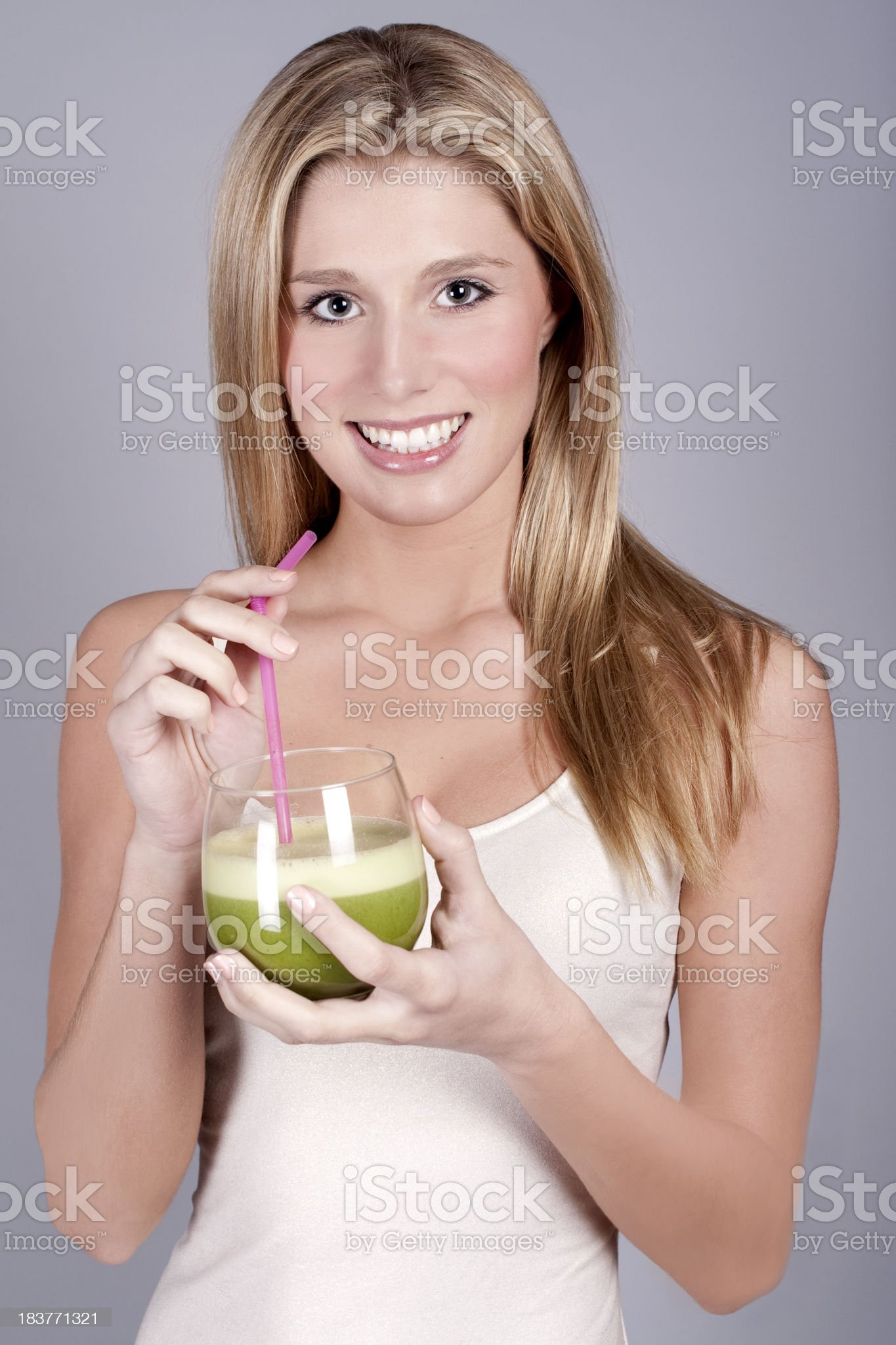 Slim Woman with Green Smoothie royalty-free stock photo