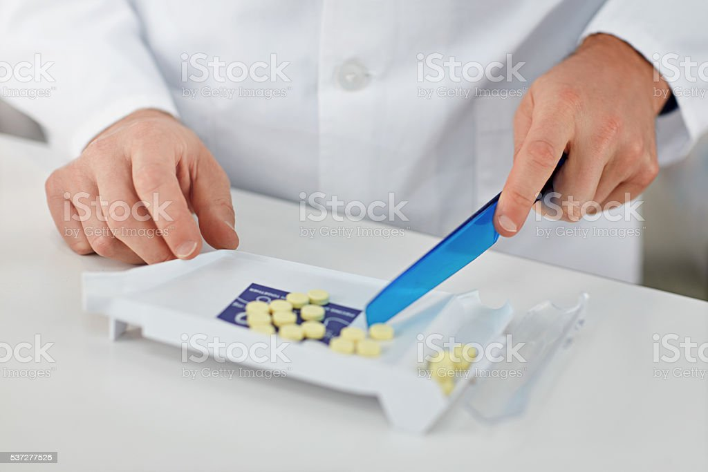 Slinging pills to pay the bills stock photo
