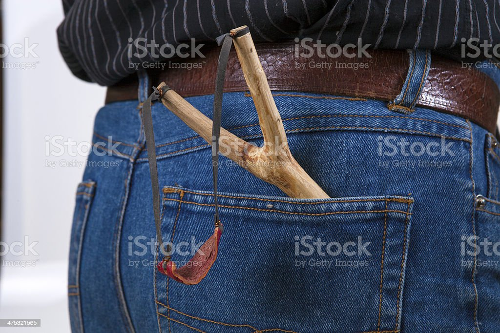 Slingshot in jeans, royalty-free stock photo