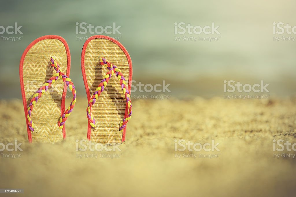slippers on beach royalty-free stock photo