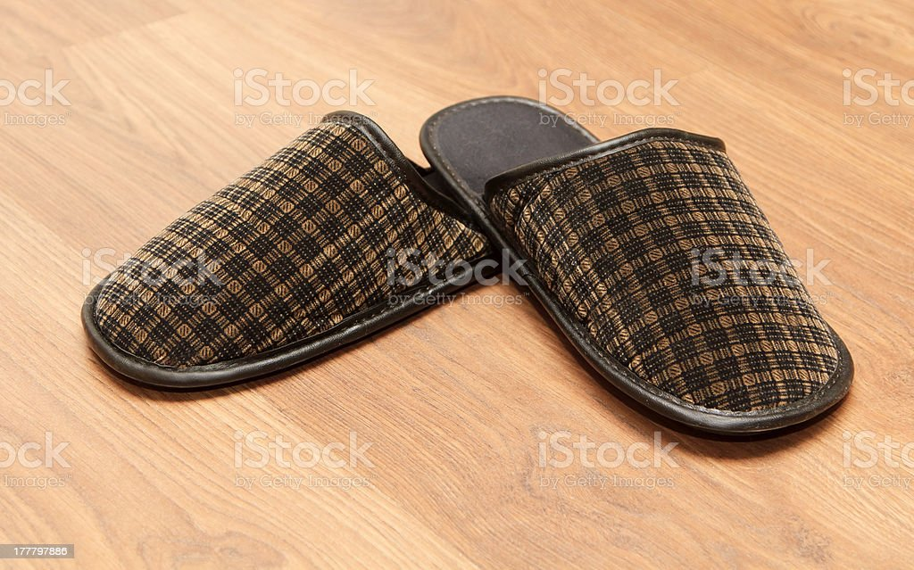 Slippers on the brown parquet floor royalty-free stock photo