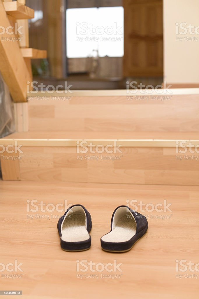 Slippers under entrance to home royalty-free stock photo