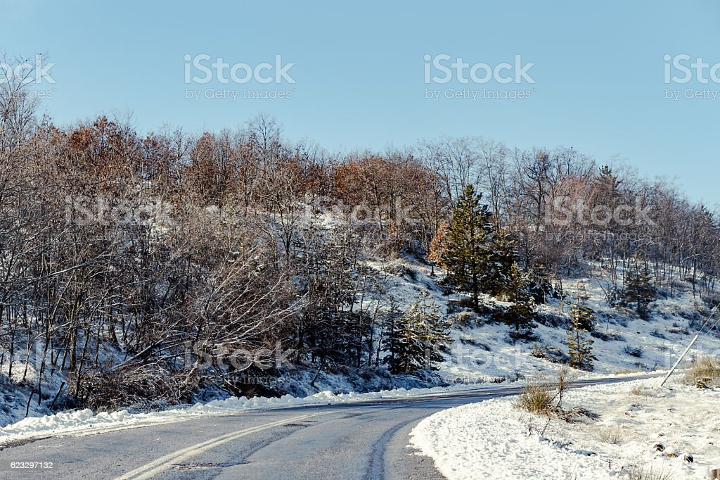 slippery and wet rural mountain road stock photo