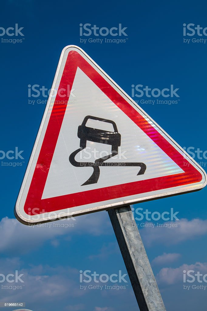 Slippery Road Warning Sign stock photo