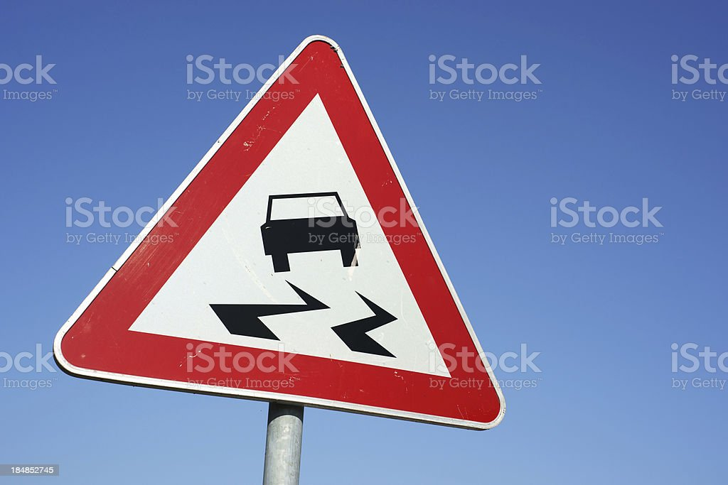 Slippery road warning traffic sign royalty-free stock photo