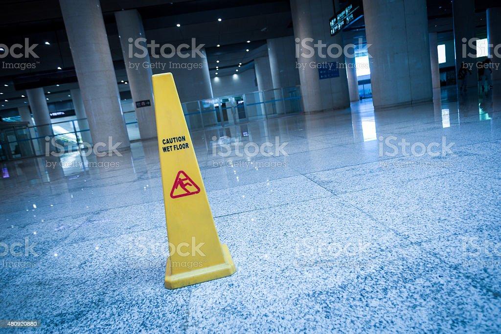 slippery sign on floor of modern building stock photo