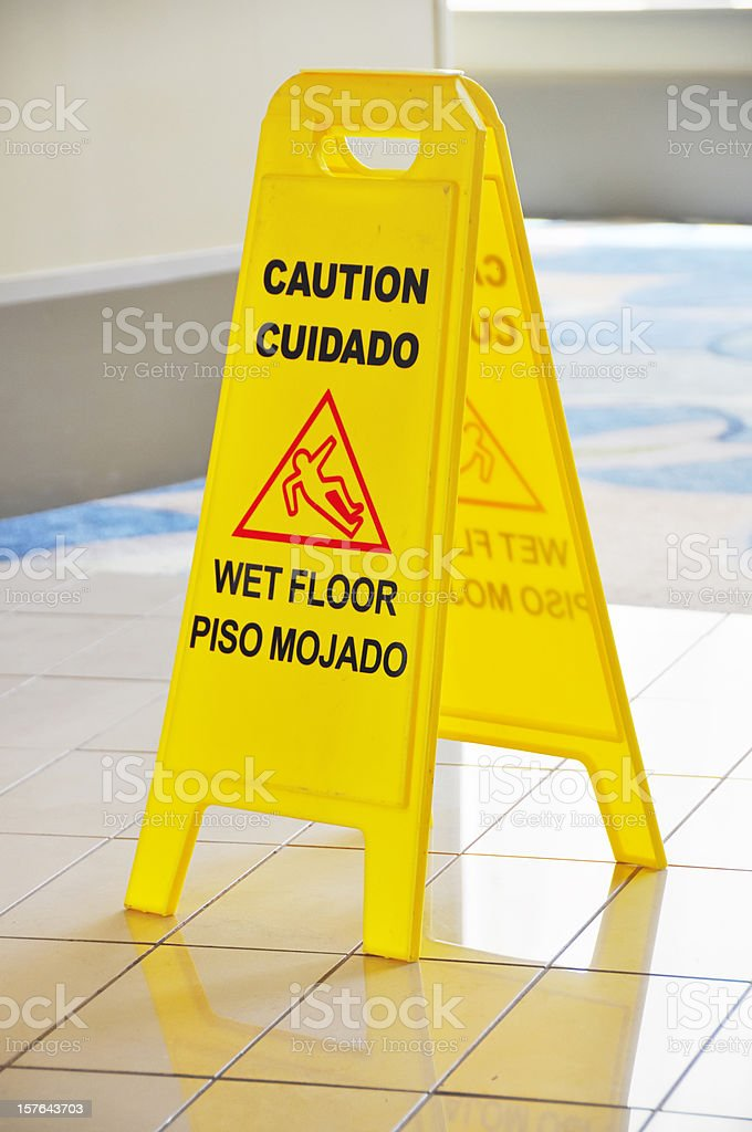 Slippery when wet sign stock photo