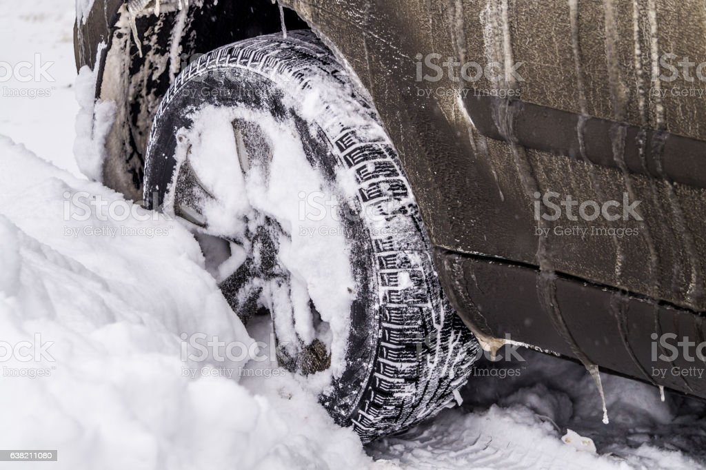 Slipping in the snow machine. Urban traffic jams in winter stock photo