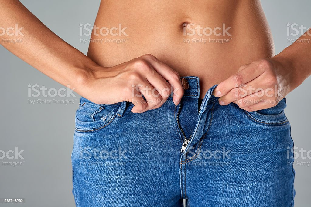 Slipping into her favourite jeans stock photo