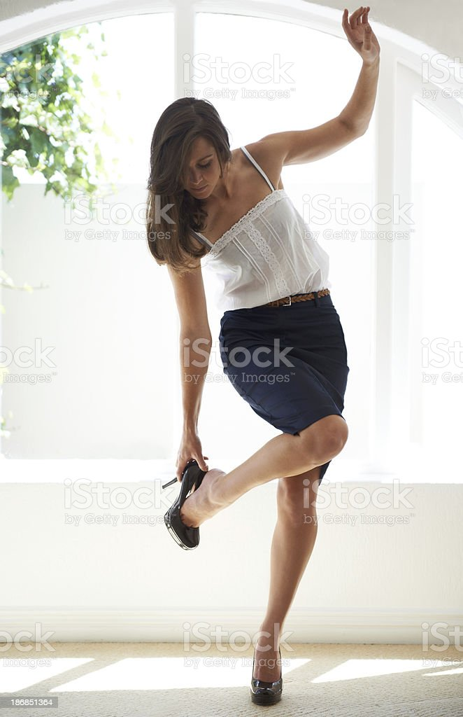 Slipping on some sexy shoes stock photo