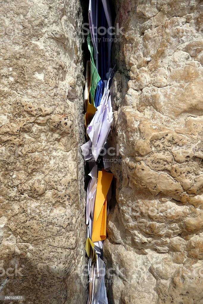 Slips of paper containing prayers in the Wailing Wall royalty-free stock photo