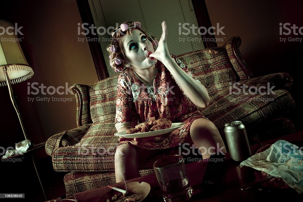 Slob Woman Eating Fried Chicken while watching Telvision royalty-free stock photo