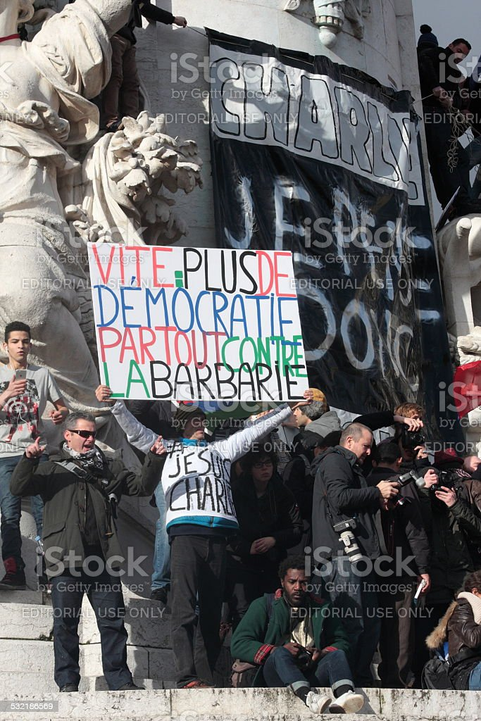 Slogan defending Democracy in manifestation, Paris stock photo