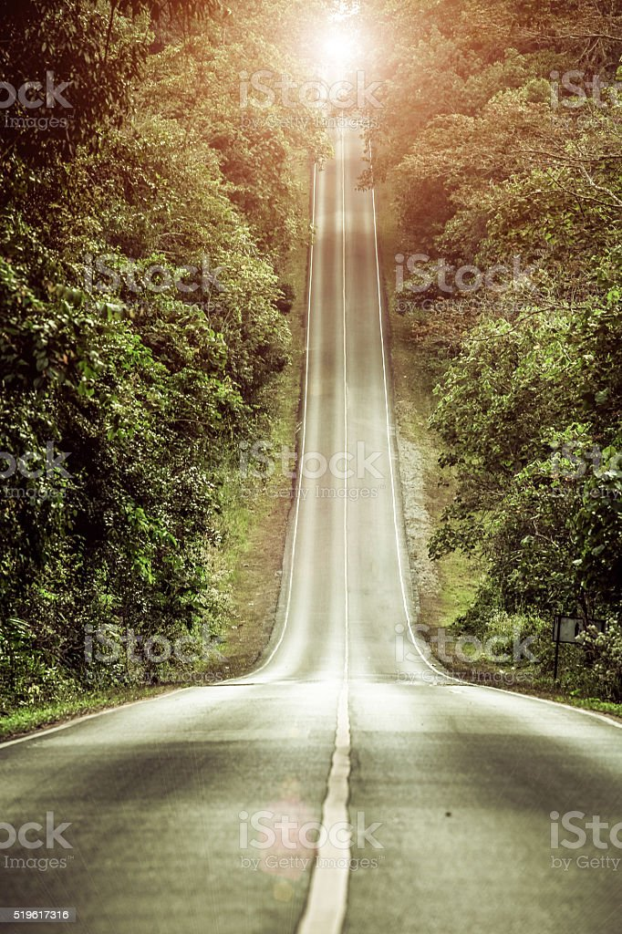 Slope mountain road with sunshine at Khao Yai, Thailand stock photo