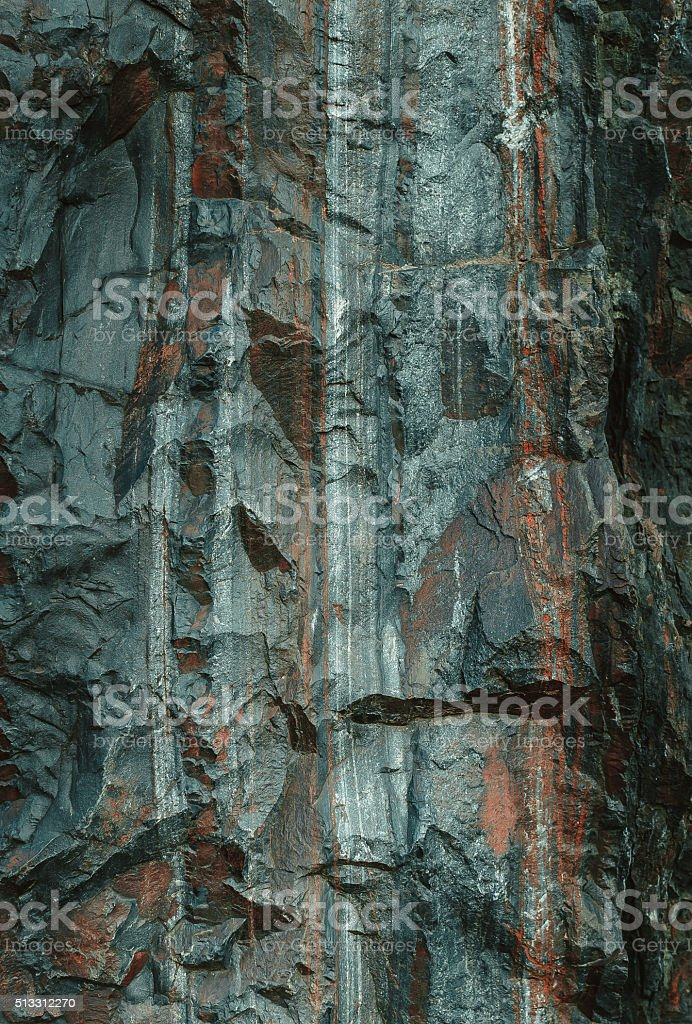 Slope of the granite cliff stock photo