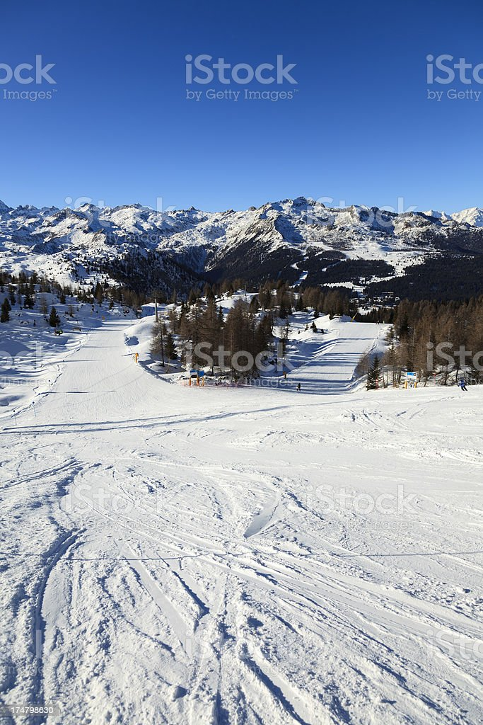 Slopes in Dolomiti with crossroad stock photo
