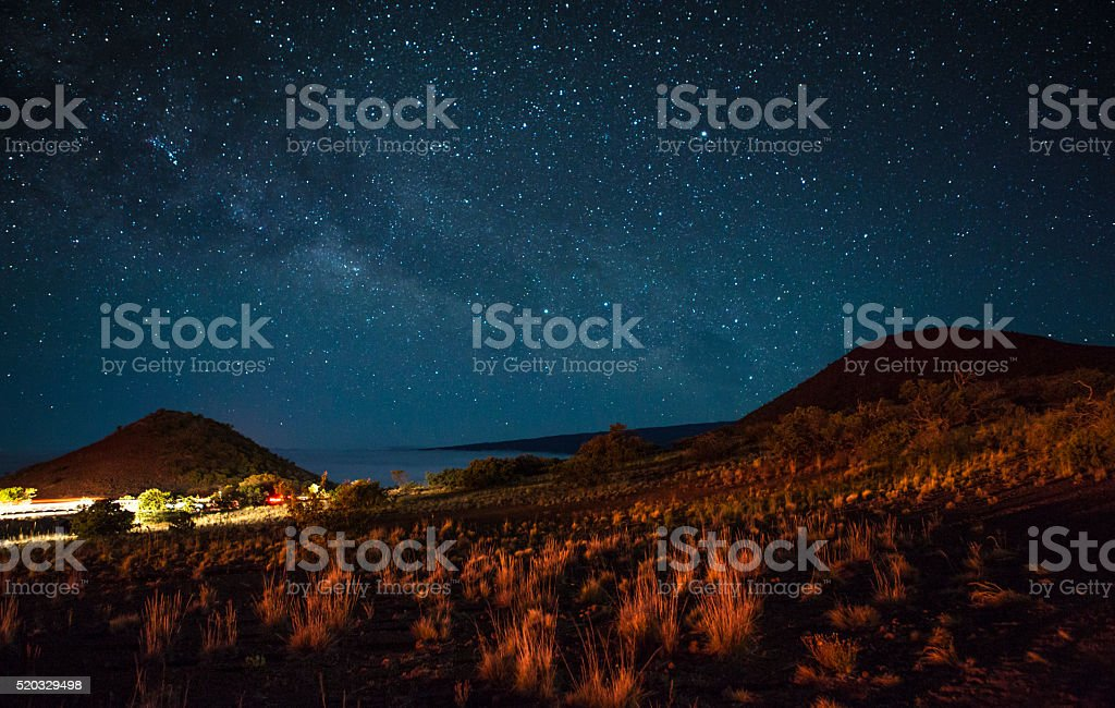Sloping Volcanic Hilside Above the Clouds stock photo
