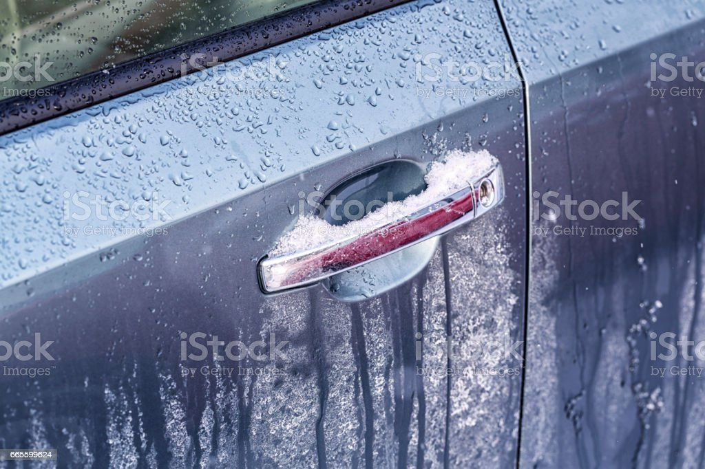 Sloppy Winter Snow Ice and Road Salt on Car Exterior stock photo