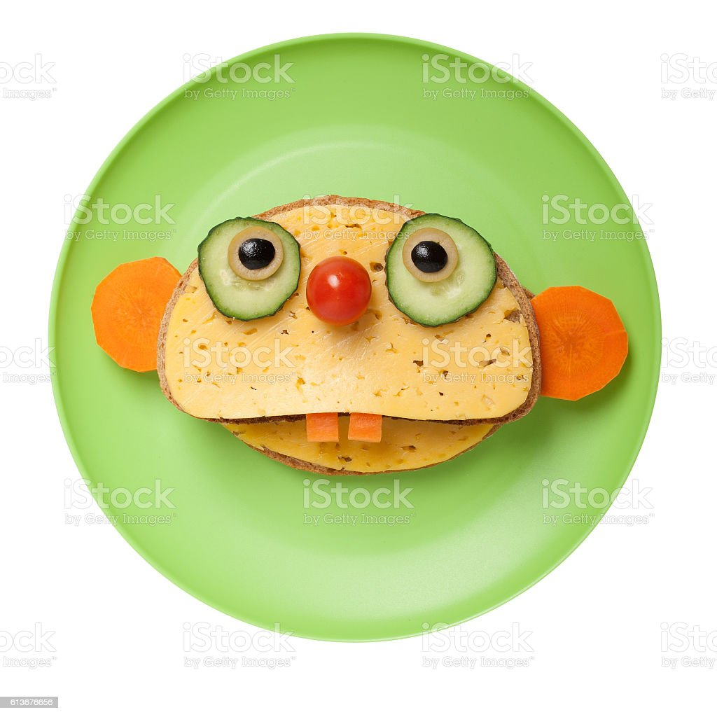 Sloth made of bread and cheese on plate stock photo