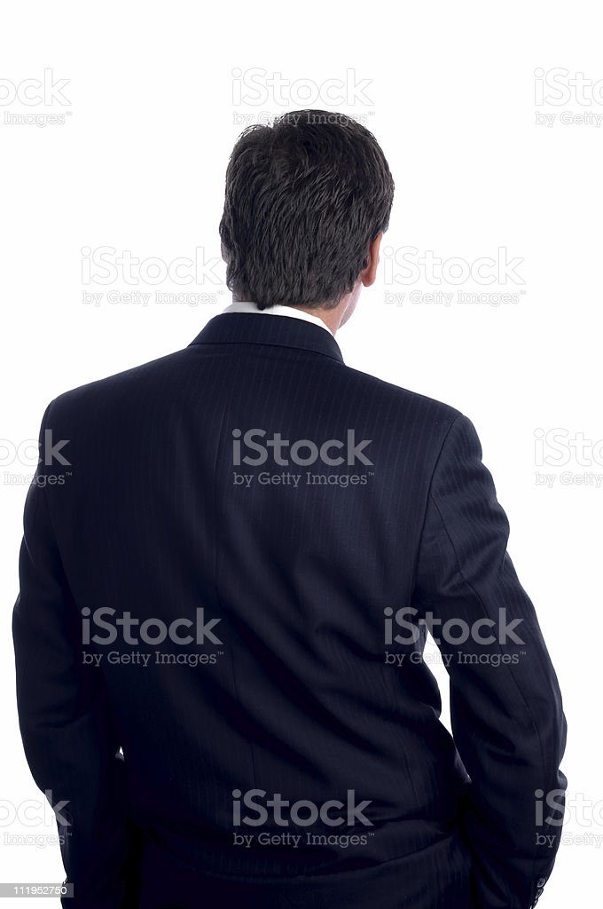 Slouching Businessman from behind Isolated on White Background royalty-free stock photo