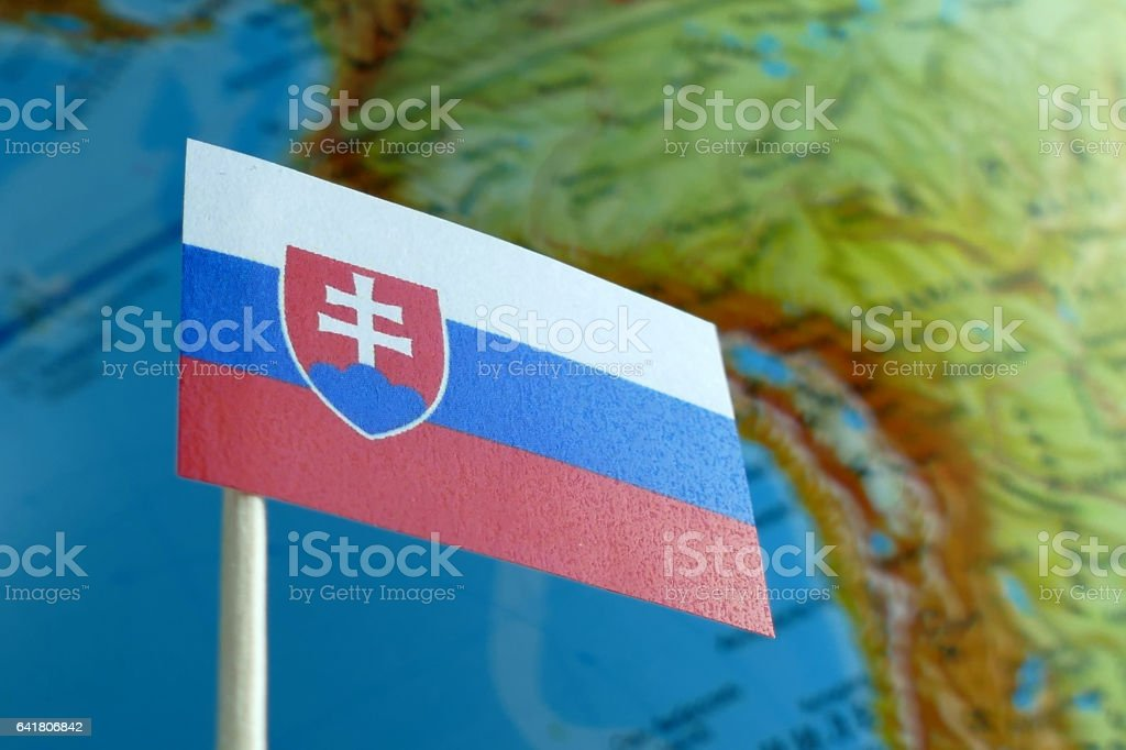 Slovakia flag with a globe map as a background macro stock photo