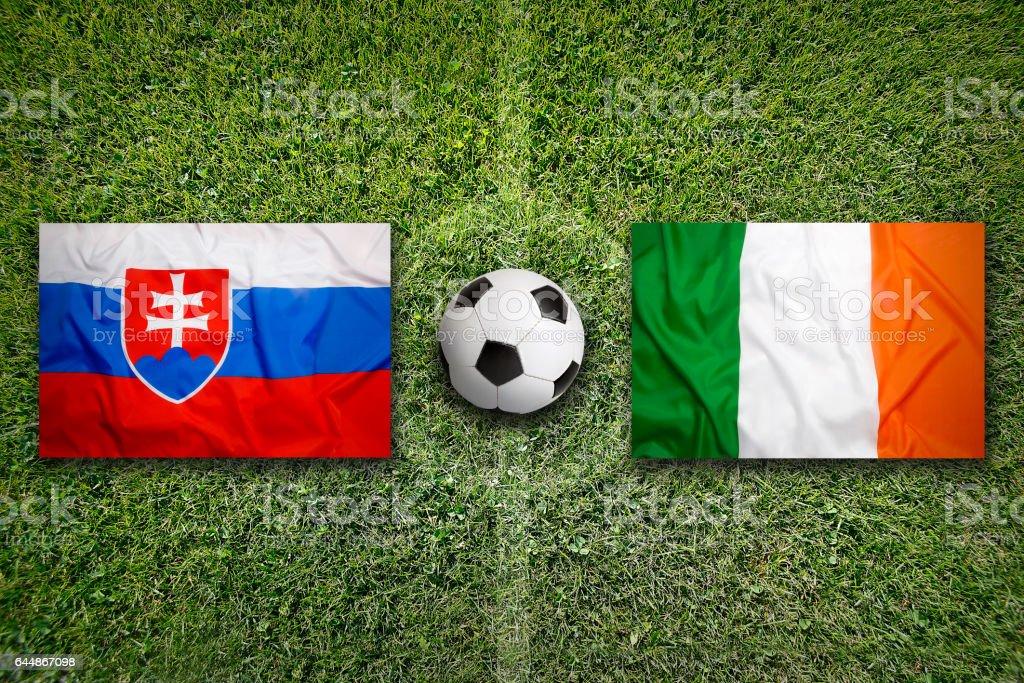 Slovakia vs. Ireland flags on soccer field stock photo