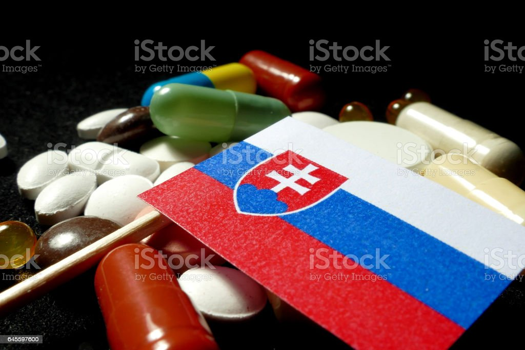 Slovakian flag with lot of medical pills isolated stock photo