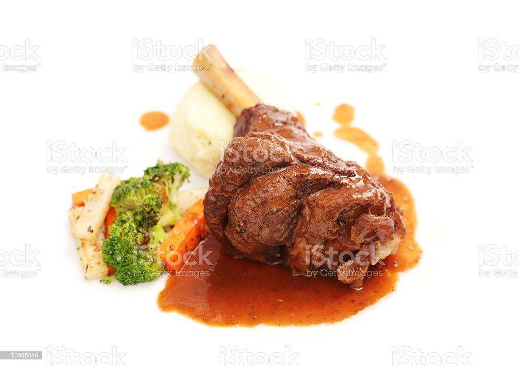Slow cooked lamb steak with vegetable and mashed potato stock photo