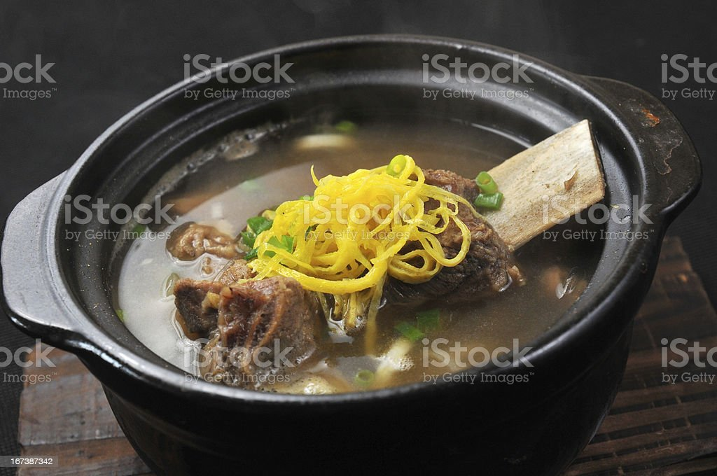 Slow cooking pot with stewed ribs and noodles royalty-free stock photo