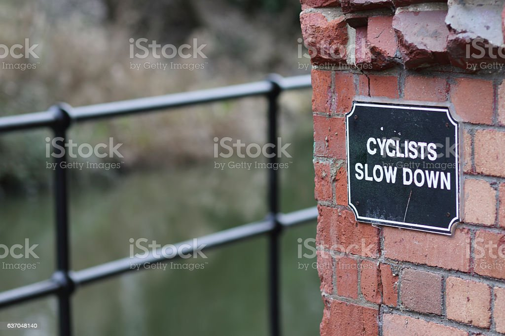 Slow down dangerous bend for cyclists on Swindon canal stock photo