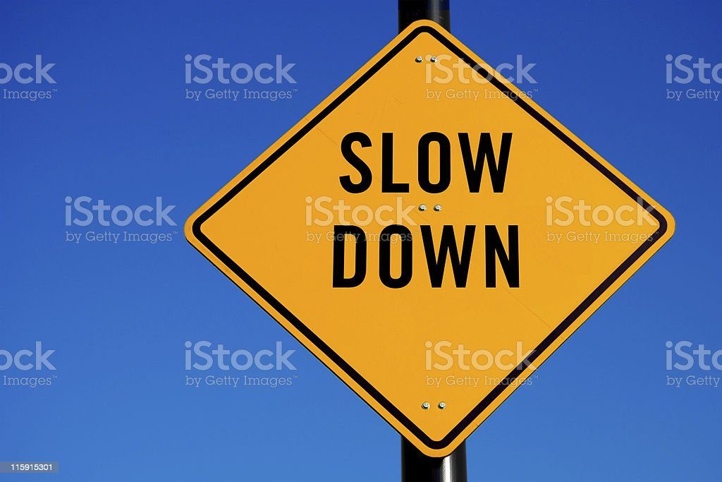 Slow Down Road Sign royalty-free stock photo