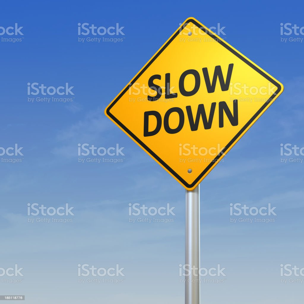 Slow Down Warning Sign stock photo