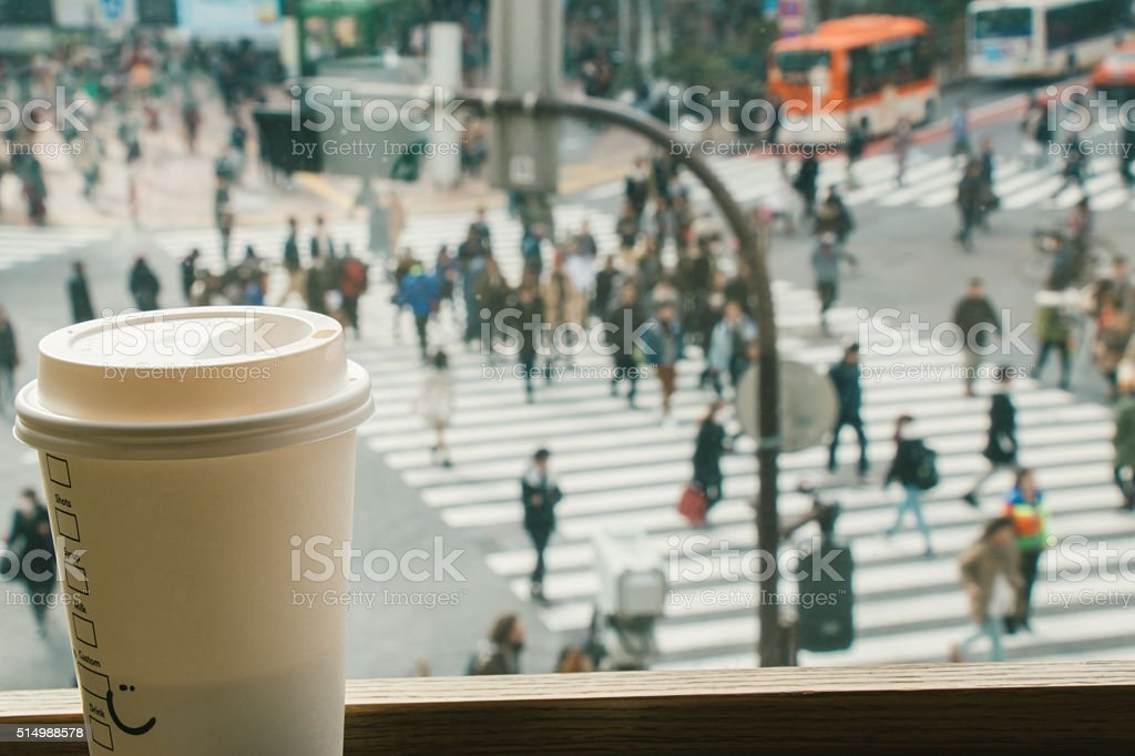 Slow life, Coffee time in rush hour of Big City with blur of people...