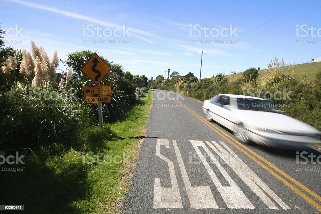 Slow marking on the road and fast car royalty-free stock photo