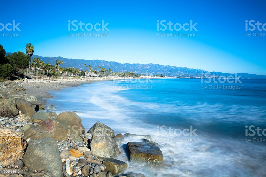 Slow motion waves on beach stock photo