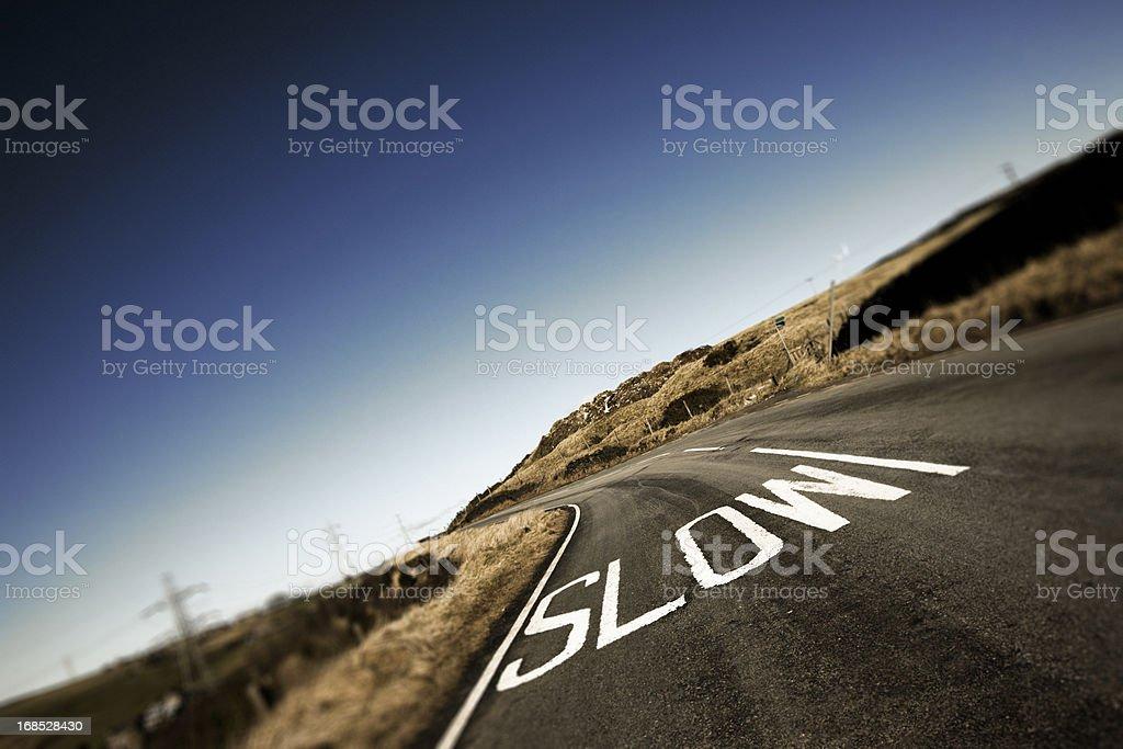 Slow Road Marking stock photo