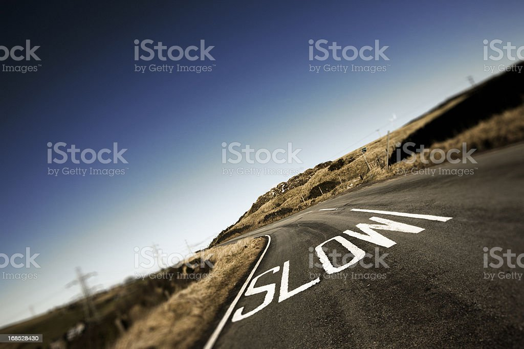 Slow Road Marking stock photo