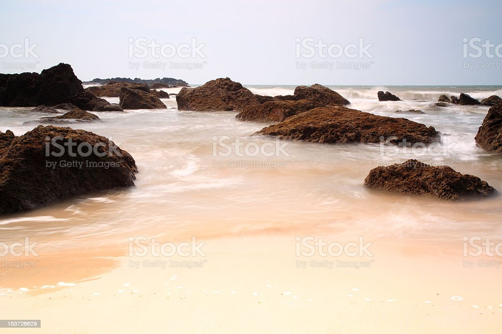 Slow shutter sea around rocks stock photo