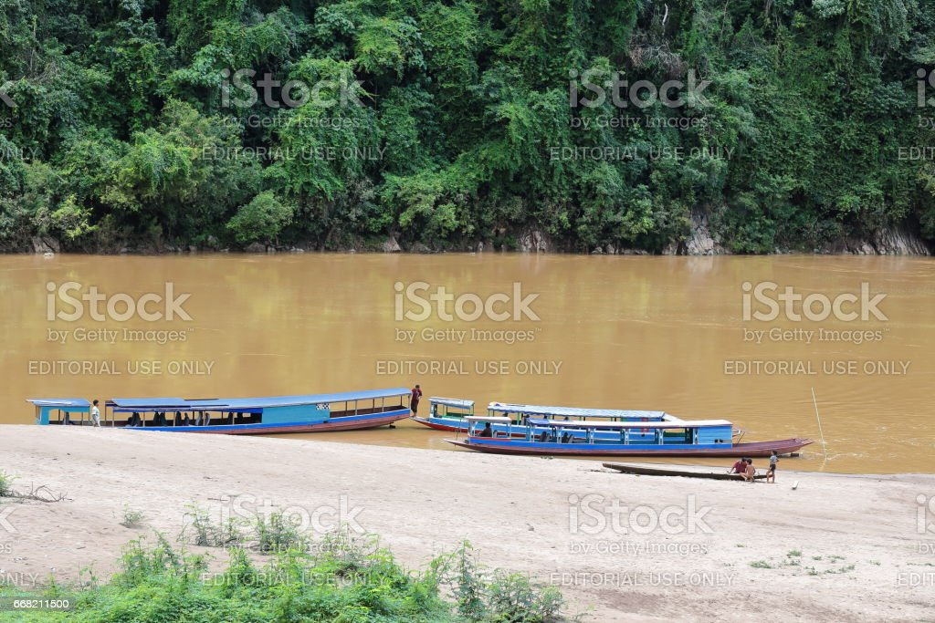 Slowboats-NamOu river bank-SopChem downstream from MuangKhua. Luang Prabang province-Laos. 3964 stock photo