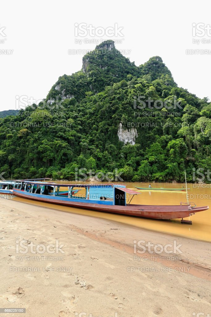 Slowboats-NamOu river bank-SopChem downstream from MuangKhua. Luang Prabang province-Laos. 3966 stock photo