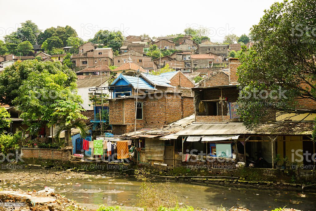Slums near dirty river photo taken in Semarang Indonesia stock photo