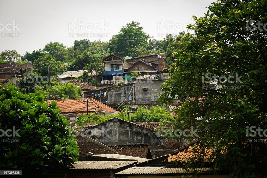 Slums on a mountain with green view photo taken in stock photo